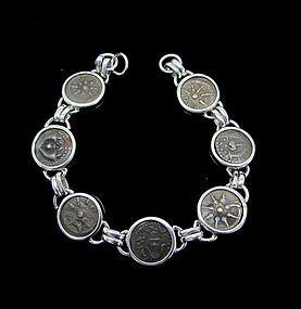 SEVEN BRONZE COINS OF ALEXANDER JANNAEUS IN SILVER BRACELET