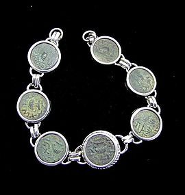 SEVEN BRONZE COINS OF THE FIRST JEWISH REVOLT IN SILVER BRACELET