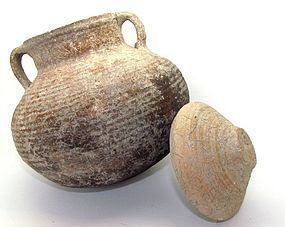 A HERODIAN TERRACOTTA COOKING POT WITH LID