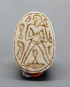 A HYKSOS PERIOD STEATITE SCARAB WITH HUMAN FIGURE
