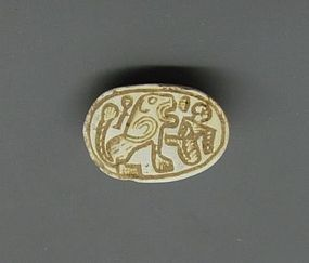 A HYKSOS PERIOD STEATITE SCARAB WITH LION AND CAPTIVE