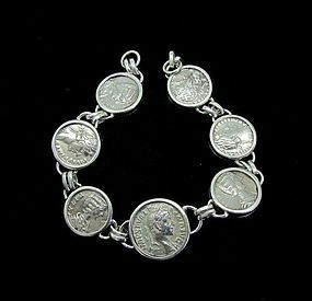 SEVEN ROMAN SILVER DENARII OF THE 2ND AND 3RD CENTURIES IN BRACELET