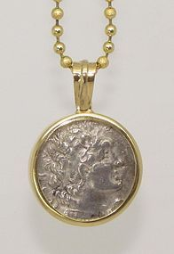 A SILVER TETRADRACHM OF PTOLEMY VI PHILOMETOR IN 14K GOLD PENDANT