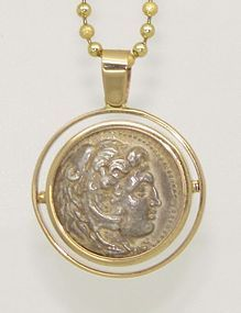A SILVER TETRADRACHM OF ALEXANDER THE GREAT IN 14K GOLD PENDANT