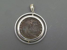 A ROMAN BRONZE FOLLIS OF GALERIUS SET IN SILVER SWIVEL PENDANT