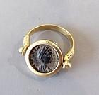 A ROMAN BRONZE FOLLIS OF HELENA AUGUSTA SET IN 18K GOLD SWIVEL RING