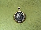 A SILVER TETRADRACHM OF ALEXANDER THE GREAT IN 18K GOLD SWIVEL PENDANT