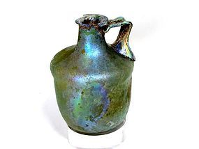A HERODIAN GLASS CYLINDRICAL JUG