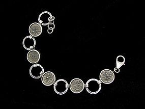 FIVE WIDOWS MITES OF ALEXANDER JANNAEUS SET IN SILVER BRACELET