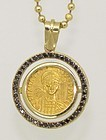 A BYZANTINE GOLD SOLIDUS OF ANASTASIUS I IN 14K GOLD AND BLACK DIAMOND