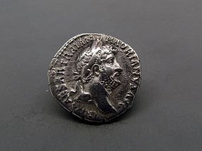 A ROMAN DENARIUS OF HADRIAN WITH PAX ENTHRONED