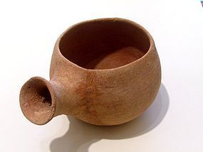AN EARLY BRONZE AGE BOWL WITH SPOUT