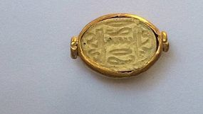 A CANAANITE HYKSOS PERIOD SCARAB IN GOLD FRAME