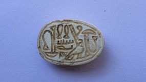 A CANAANITE STEATITE SCARAB WITH PSEUDO HIEROGLYPHIC SCRIPT