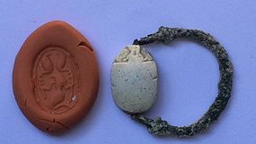 A CANAANITE STEATITE SCARAB WITH ORIGINAL BRONZE RING