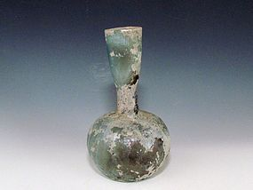 A LATE ROMAN GLASS BOTTLE
