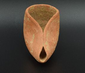 A HASMONEAN TERRACOTTA OIL LAMP
