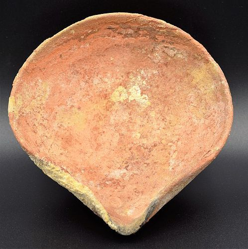 A MIDDLE BRONZE AGE OIL LAMP