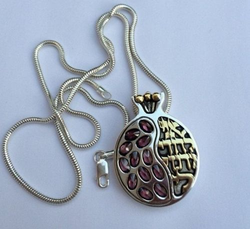 A HANDMADE SILVER PENDANT WITH GARNETS AND GOLD HEBREW INSCRIPTION