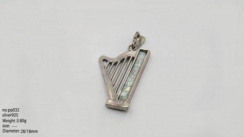 A ROMAN GLASS FRAGMENT IN SILVER HARP PENDANT