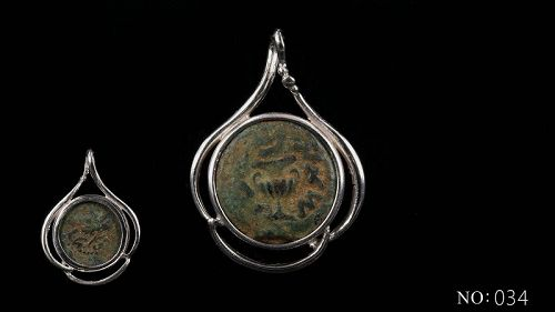 A MASADA PRUTAH OF THE FIRST JEWISH REVOLT IN SILVER TREFOIL PENDANT