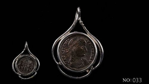 A ROMAN BRONZE COIN OF CONSTANTINE THE GREAT IN SILVER TREFOIL PENDANT