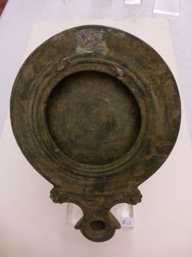 A ROMAN BRONZE OIL LAMP