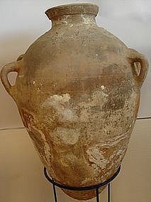 A LARGE CANAANITE TERRACOTTA FOUR HANDLE AMPHORA