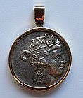 A GREEK SILVER COIN IN 18K GOLD SETTING