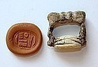 A GLAZED STEATITE SEAL ON BRONZE RING NAMING AMUN-RE