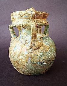 A ROMAN GLASS THREE HANDLED COSMETIC JAR
