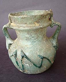 A LATE ROMAN GLASS TWO-HANDLED JAR