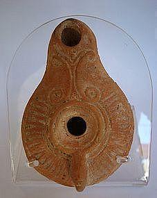 A ROMAN TERRACOTTA OIL LAMP