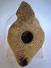 A LARGE JEWISH-SAMARITAN TERRACOTTA OIL LAMP
