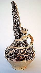 A LARGE ISLAMIC UNGLAZED POTTERY JUG