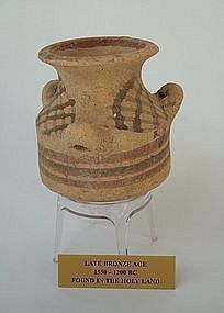 A CANAANITE TERRACOTTA PYXIS WITH THREE HANDLES