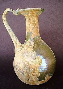 AN EXCEPTIONAL ROMAN BLOWN GLASS PITCHER