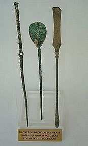 THREE ROMAN BRONZE MEDICAL AND SURGICAL INSTRUMENTS