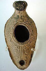A BYZANTINE TERRACOTTA OIL LAMP