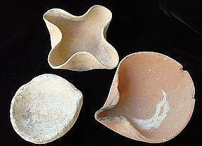 THREE CANAANITE CLAY OIL LAMPS