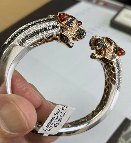 An Astonishing 10.05ct Diamond Leopard 18k & Palladium Bangle