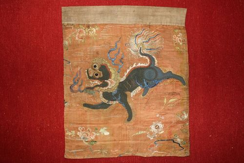 Embroidered silk lion