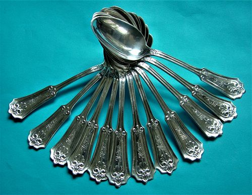 "John Cook ""Anthemion"" coin silver teaspoons, 12"
