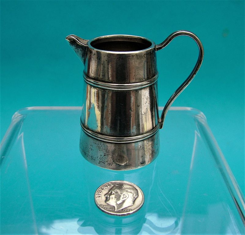Massive and imposing sterling pitcher by Simons Brothers