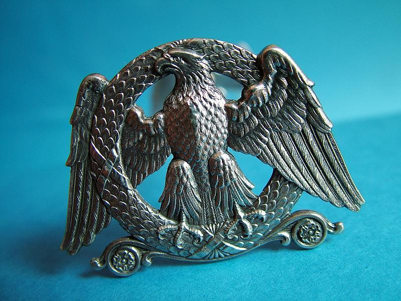 a good pair of Belgian Eagle motif silver knife rests,