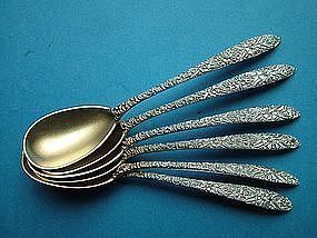 12 Antique, chased egg spoons with gilt matte finish