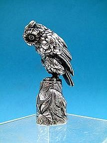 a fine full figural owl desk seal,  pale emerald eyes
