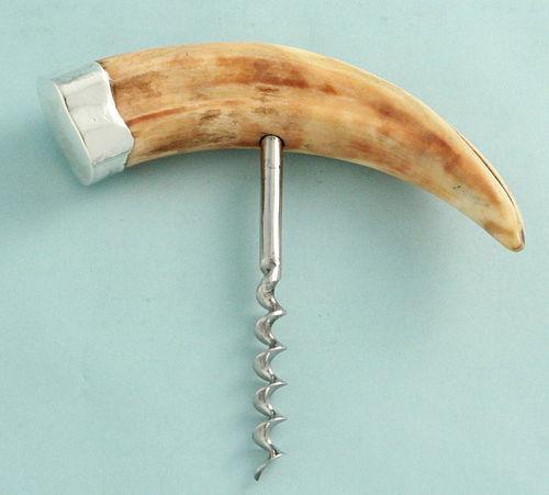 Antique Boar Tusk and Silver Corkscrew