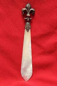 Bronze handled paper knife with mother-of-pearl blade