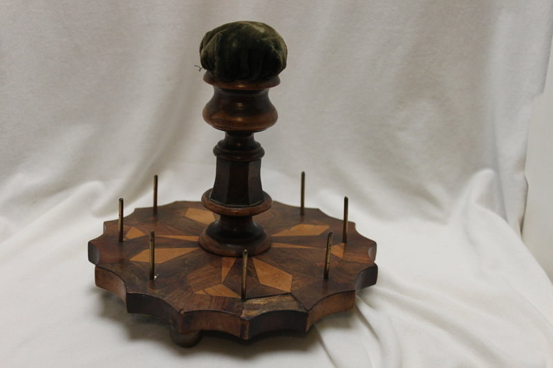 Inlaid sewing reel stand and pincushion